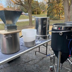 Jef's homebrewing setup includes an electric kettle, grain mill, and conical fermenters.
