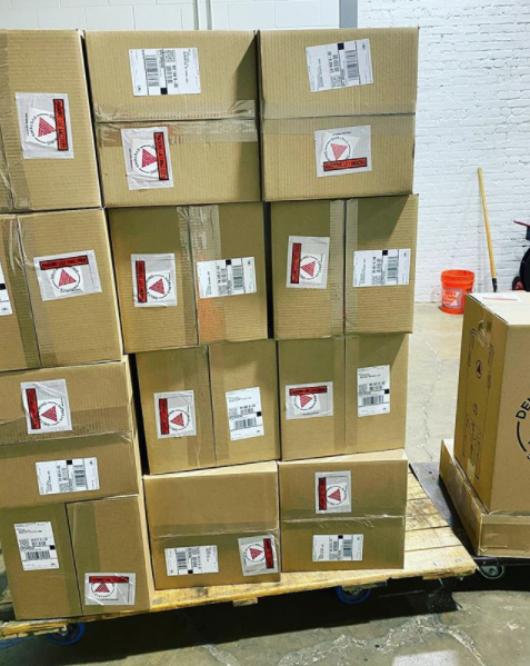 Image of several boxes of DBS equipment packed and ready for shipment.