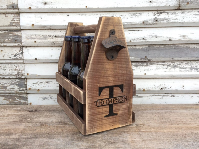 An image of one of the handcrafted wood six pack beer caddies.