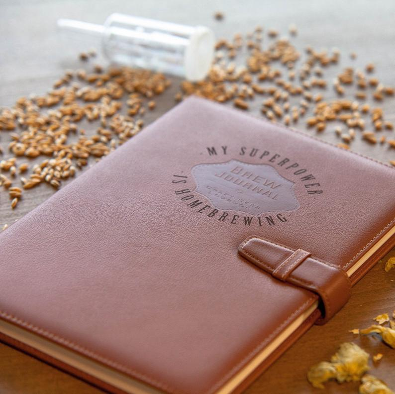 Image of the personalized brew journal with grain, hops, and an airlock around it.